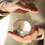 Businessman holding mini globe — Stock Photo