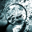 Royalty-Free Stock Photo: Magnifying glass, puzzle