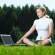 The girl with laptop on a green lawn — Photo