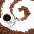 Cup with coffee, costing on coffee grain — Stock Photo
