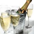 Champagne flutes and ice bucket — Stock Photo #1668177
