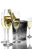 Champagne flutes and ice bucket — Stock Photo