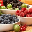 Berries in plates, on a table - Stock Photo