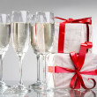 Royalty-Free Stock Photo: Glasses of champagne, gifts with tapes