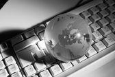 Globe and keyboard — Stock Photo