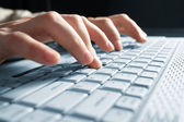 Male hands typing on a laptop — Foto Stock