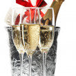 Champagne flutes and ice bucket — Stock Photo #1750442