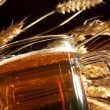 Stock Photo: Glass of beer with grain