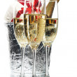 Champagne flutes and ice bucket — Stock Photo #1758679