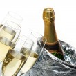 Stock Photo: Champagne flutes and ice bucket