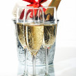 Champagne flutes and ice bucket — Stock Photo #1761386
