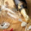 Champagne sparkling on a beach — Stock Photo #1761670