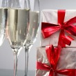 Royalty-Free Stock Photo: Glasses of champagne, gifts