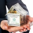 The house money in human hands — Stock Photo