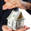 Stock Photo: The house money in human hands