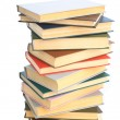 Stock Photo: Books built in high pile.