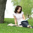 Stock Photo: Girl with the book on the nature