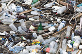Garbage in river, pollution — Stock Photo