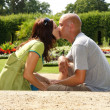 Stock Photo: Lovers kissing in garden