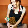 Stock Photo: Red head girl and teddy bear