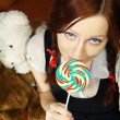 Stock Photo: Red head girl with lollipop and teddy