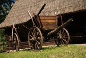 Old wood cart under barn — Stock Photo