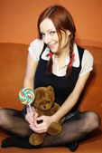 Red head girl and teddy bear — Stock Photo