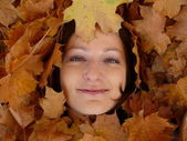 Woman face in leaves — Stock Photo