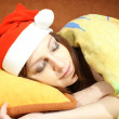 Stock Photo: Sliping womwith Santcap