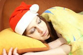 Sliping woman with Santa cap — Stock Photo
