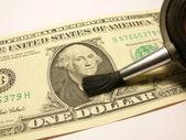 Sweeping dollar — Stock Photo