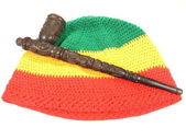 Pipe and reggae cap — Stock Photo