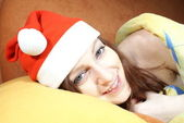 Smiling woman in Santa Claus cap — Stock Photo