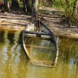 Stock Photo: Old rowing boat in water