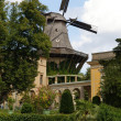 Stock Photo: Old windmill in garden