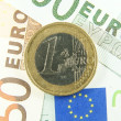 Stock Photo: One euro coin on euro cash.