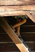 Legs of some lady on old wood stairs — Stock Photo