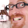 Doctor with poison bottle — Stock Photo #1659685