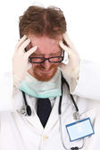 Doctor having headache — Stock Photo