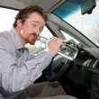 Stock Photo: Drivers with a bottle alcohol