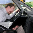 Driver using GPS laptop — Stock Photo