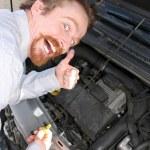 Checking engine oil dipstick — Stock Photo
