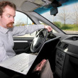 Stock Photo: Driver using gps laptop