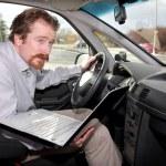Driver using gps laptop — Stock Photo #1693536