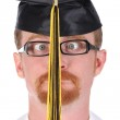 Very funny graduation a young man — Stock Photo