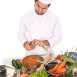 Stock Photo: Young chef preparing lunch