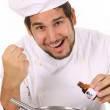 Preparing lunch with poison bottle - Stock Photo