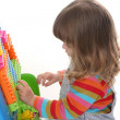 Girl playing building toy blocks — Foto de Stock