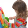 Girl playing building toy blocks — ストック写真