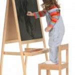 Beauty a little girl writing — Stock Photo